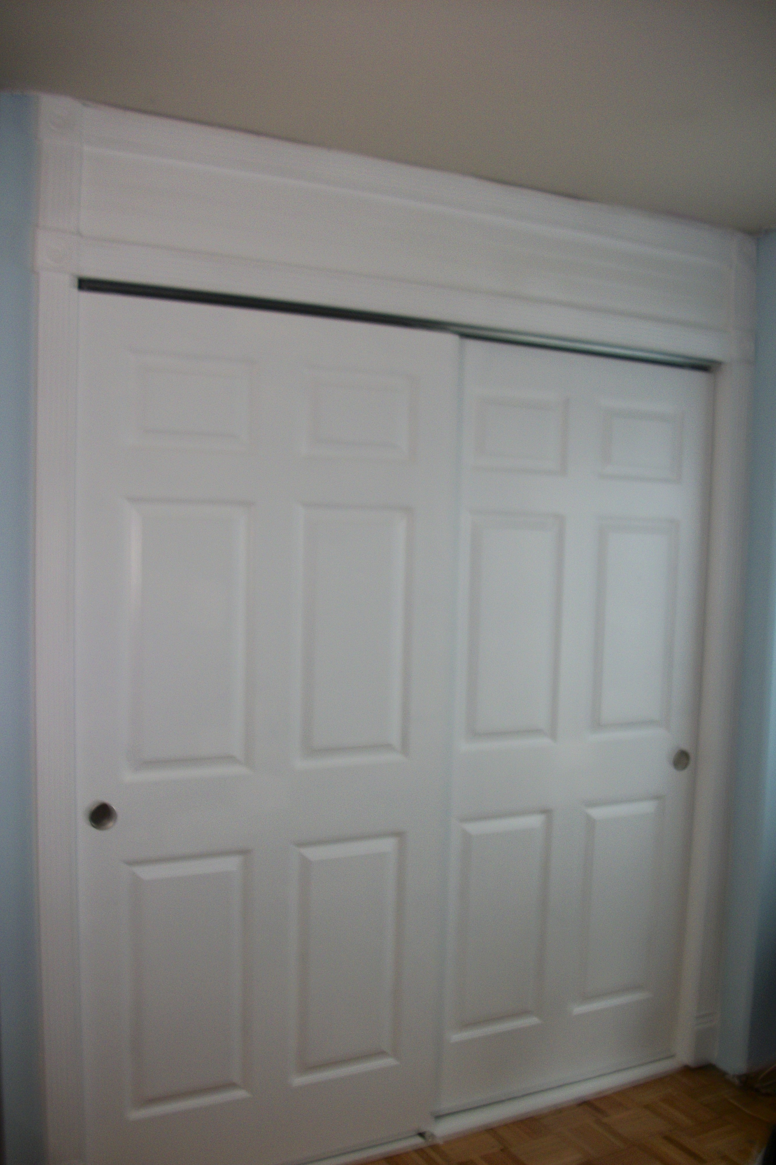 White Sliding Closet Door